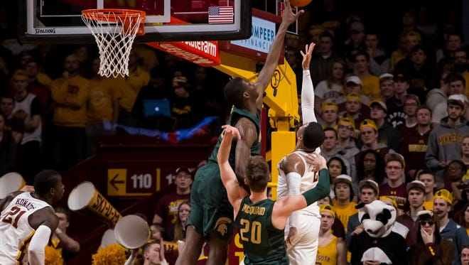 Michigan State Spartans forward Jaren Jackson Jr. (2) blocks Minnesota Gophers guard Nate Mason (2) in the first half at Williams Arena.
