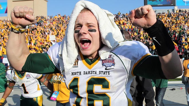 North Dakota State's Brock Jensen, celebrating last season's national title, has quarterbacked the Bison to an FCS-record 44 wins in his career.