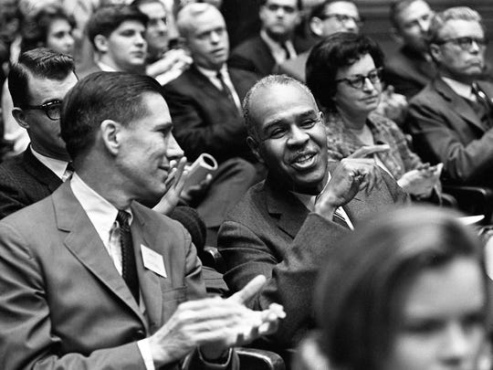 Civil Rights leader Roy Wilkins, right, makes a humorous