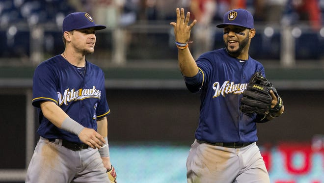 There is no guarantee Scooter Gennett (left) will start at second base if the Brewers plan to give Jonathan Villar more time at that position.
