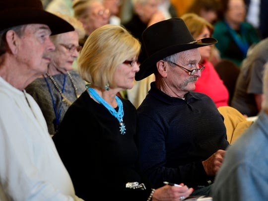 Auction goers look for the next auction item during the March in Montana live auction on Friday at the Townhouse Inn.