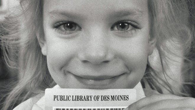 Rozanne Sieglaff, then a first-grader at Rice Elementary, is all smiles after picking up her library card during a class field trip to the Main Library in downtown Des Moines on Sept. 28, 1989.
