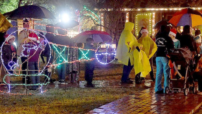 A drizzling rain wasn't going to stop holiday revelers from attending the Lighting of the Village on Dec. 2 at Le Vieux Village in Opelousas.