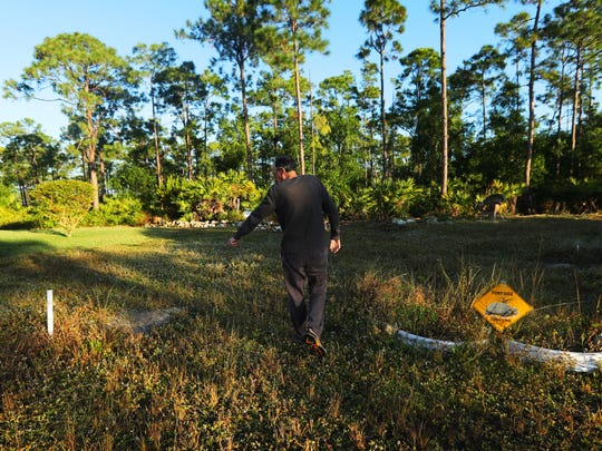 Cape Coral resident Rick Aliperti points to one of several tortoise burrows on his vacant land. Aliperti is affectionately known as the Tortoise Guy in his neighborhood because of the generous steps he has taken to protect the tortoises that live next to his property.