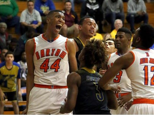 Bartow's Tony Bradley celebrates a basket against Osceola