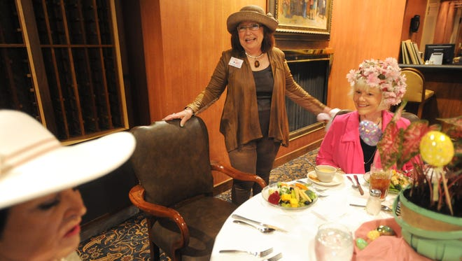 Donna Albus eats lunch with her Carousel group at the Abilene Country Club April 13, 2017.