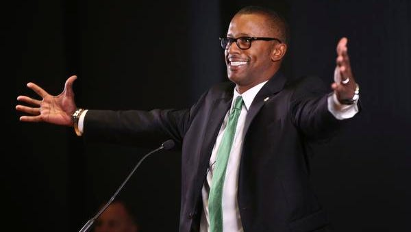 New University of Oregon NCAA college football coach Willie Taggart jokes with the audience during an introductory press conference in Eugene, Ore., Thursday Dec. 8, 2016.  (Chris Pietsch/The Register-Guard via AP)