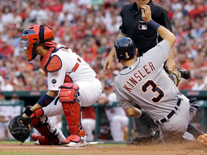 The Tigers' Ian Kinsler (3) scores past Cardinals catcher