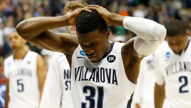 Mar 21, 2015; Pittsburgh, PA, USA; Villanova Wildcats guard Dylan Ennis (31) reacts after the game against the North Carolina State Wolfpack in the third round of the 2015 NCAA Tournamentat Consol Energy Center. The Wolfpack won 71-68. Mandatory Credit: Geoff Burke-USA TODAY Sports