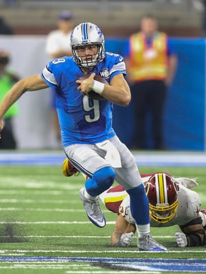 Lions quarterback Matthew Stafford runs past the Washington Redskins' Ryan Kerrigan for a first down during the second half Sunday, Oct. 23, 2016 at Ford Field in Detroit.