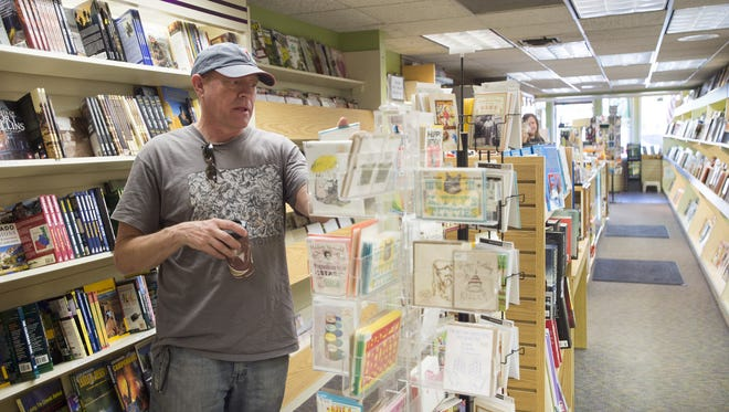 Roberto Verde shops for a greeting card at Al's Newsstand on May 12.