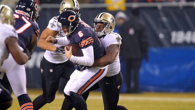 Chicago Bears quarterback Jay Cutler (6) is sacked by New Orleans Saints inside linebacker David Hawthorne (57) during the second quarter at Soldier Field.
