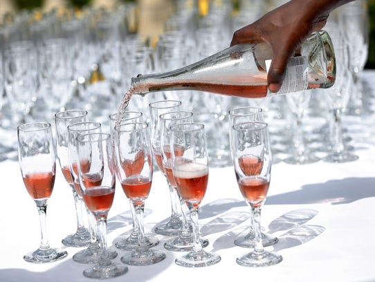 A 2015 IndyStar file photo of wine being poured into