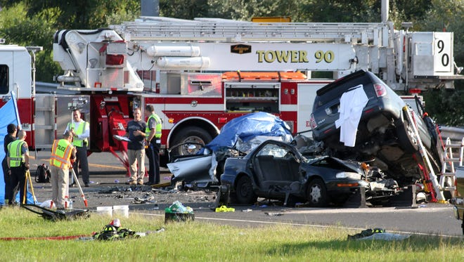 Scene of a fatal accident on Kozloski Road near the entrance ramp to Route 33 West Tuesday August 20, 2014, Freehold Township, NJ.      Photo by Robert Ward