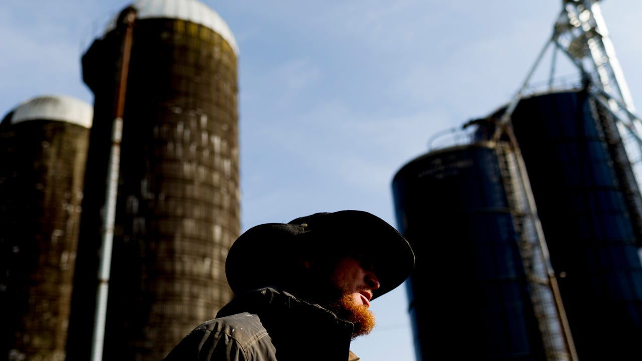 Dairy farmer Caleb Watson talks about his termination from Dean Foods on his farm in Sweetwater, Tennessee, on Friday, February 9, 2018.