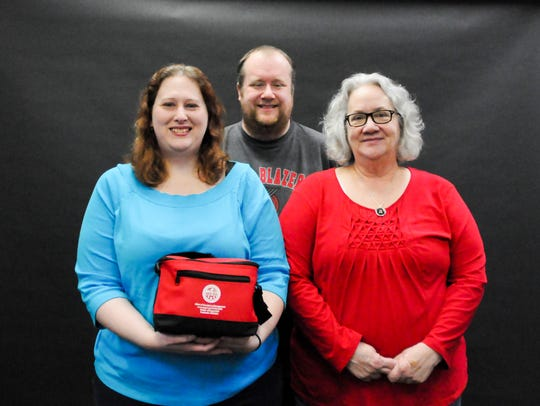 (Left to right) Amanda Ferris, Matthew Ferris and Mary