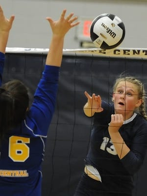 Jozee Evans lays the ball over the net for Central Catholic.
