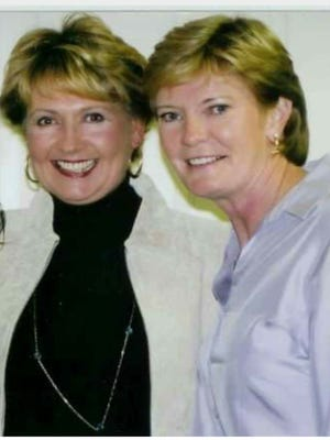 Julia Brundige and Pat Summitt smile for a photo years after their playing days at UTM were over.
