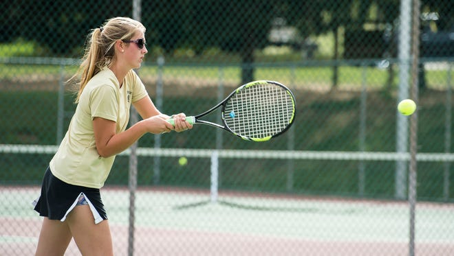 Delone Catholic's Ellie Neudecker hits the ball to Kennard-Dale's Meghan Silva during the 2017 YAIAA 2A singles tennis tournament at South Western on Thursday, Oct. 5, 2017.