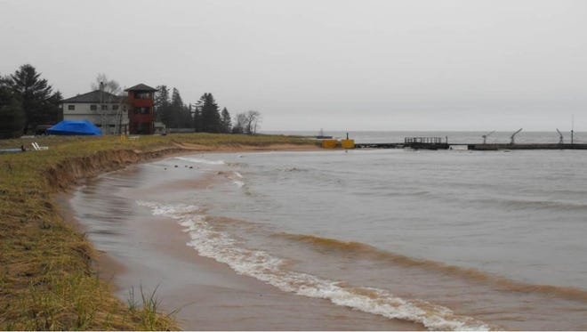 Pier owner Philip Myers' home as seen from the lot of  a neighbor who contends the pier has led to erosion of his beach on Madeline Island.