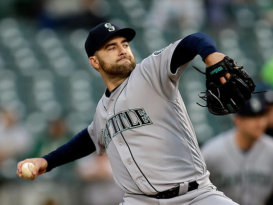 Seattle Mariners pitcher Nathan Karns works against the Oakland Athletics in the first inning of a baseball game Monday, May 2, 2016, in Oakland, Calif. (AP Photo/Ben Margot)
