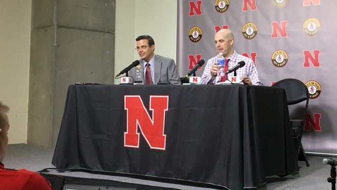 Tim Miles (left) and Craig Smith shared the stage on Saturday after Nebraska's 73-61 win over USD.