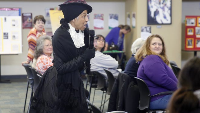 Frances Vitali portrays Harriet Tubman during a Martin Luther King Jr. Day celebration on Monday at San Juan College in Farmington.