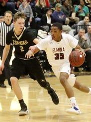 Mikey Swarez of Elmira drives toward the hoop as he