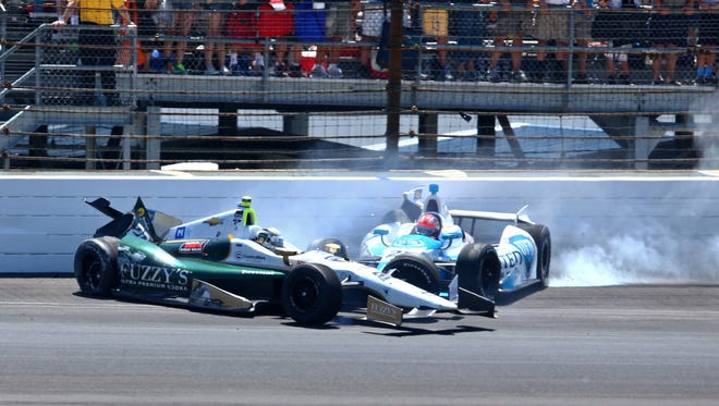 Ed Carpenter (20) and James Hinchcliffe (27) crash in Turn 1 during the 2014 Indianapolis 500.