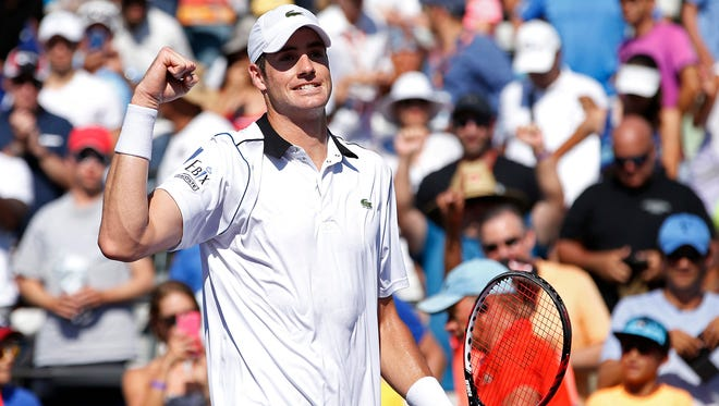 John Isner celebrates after his match against Kei Nishikori on day eleven of the Miami Open.