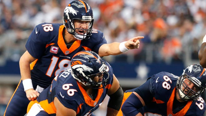 Broncos C Manny Ramirez (66) and QB Peyton Manning form the battery of the highest-scoring offense in NFL history.