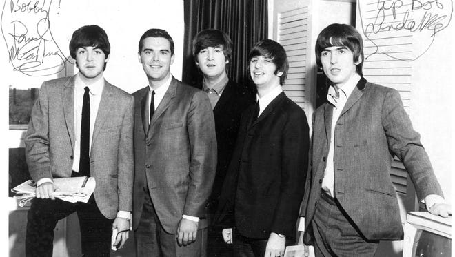 In September 1964, Bob Barry (second from left) poses with the Beatles the morning after their Milwaukee concert. Barry will talk about meeting the legendary rock band and other highlights of his 30-year career as a local radio icon at The Cavern in Hartland Tuesday, Sept. 4.
