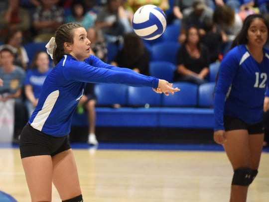 Cotter's Macie Clawson makes a pass against Valley