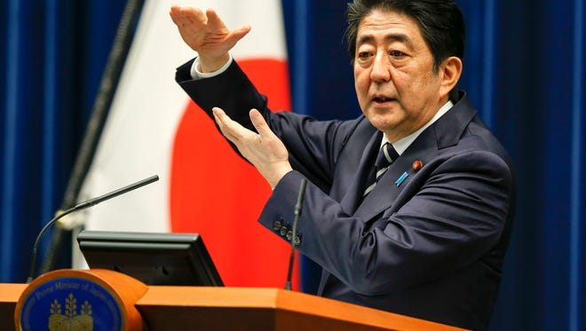 Japanese Prime Minister Shinzo Abe speaks during a news conference in Tokyo on March 29, 2016. Japan's parliament enacted a record budget for 2016, focusing on welfare matters.