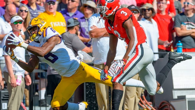 LSU wide receiver Terrace Marshall Jr. (6) makes a reception against Georgia defensive back Tyson Campbell (3) in the first half of an NCAA college football in Baton Rouge, La., Saturday, Oct. 13, 2018. (AP Photo/Matthew Hinton)