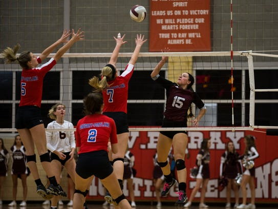 Flour Bluff's Sierra Howe tips the ball over Gregory-Portland'