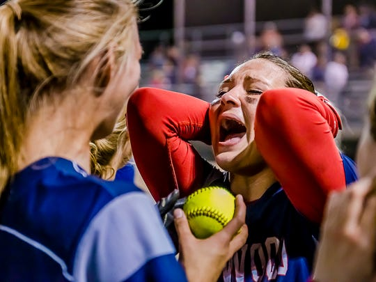 Sierra Stoepker of Lakewood is overcome with emotion as a teammate presents her with the game ball after she hit a walk-off homerun to win their Softball Classic championship Friday.