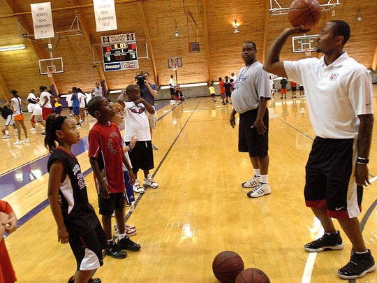 Kids participating in Cleveland Cavaliers guard Mo Williams' basketball camp pay close attention as he demonstrates the proper release technique when shooting the ball. The camp is being conducted at Millsaps College in Jackson.