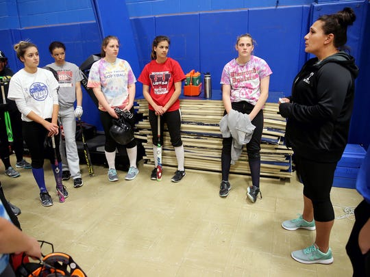 Olympic High School softball coach Jessica Cabato addresses her team during an indoor practice this week.