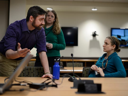 Andrew Regent-Smith, left, a first year student at the Medical College of Wisconsin in Milwaukee, talks with MCW-Milwaukee's Anna Narvey, project coordinator, and Alexis Meyer, administrator assistant in the office of admissions, as they test computer and video equipment Tuesday in the new MCW-Green Bay building on the St. Norbert College in De Pere.