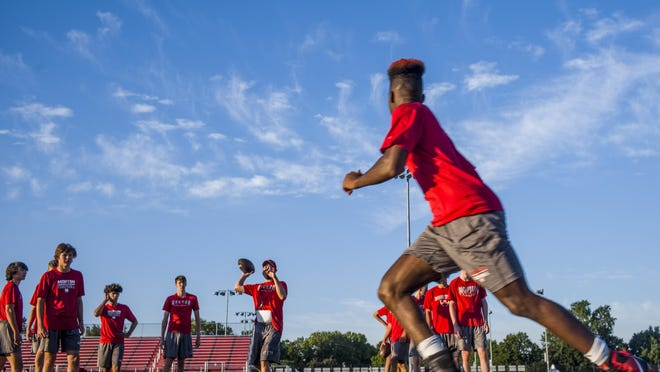 Morton High School's Josh Knight, foreground, turns to eye a pass during early morning practice Wednesday, July 29, 2020 in Morton.