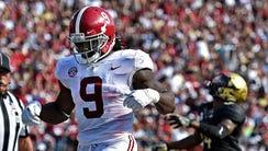 Alabama running back Bo Scarbrough (9) scrolls into