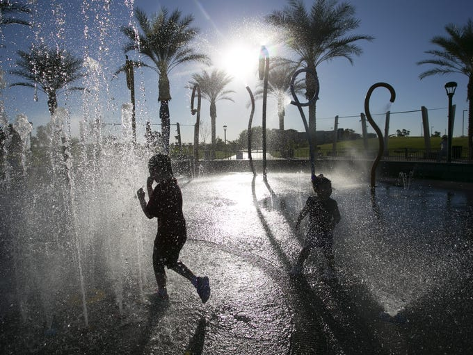 As temperatures near triple digits, Amara Hanson, 7,