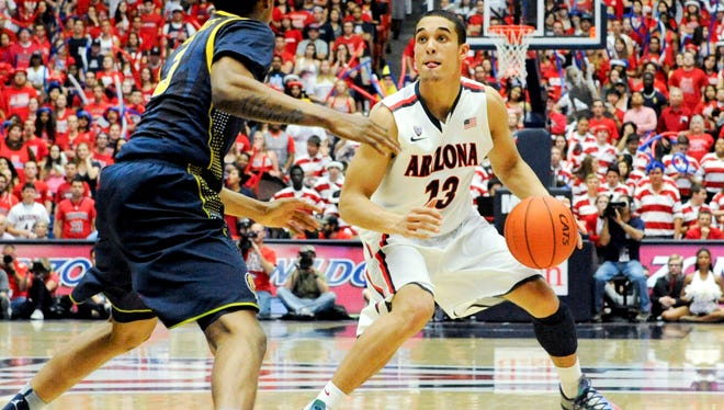 Arizona Wildcats guard Nick Johnson is defended by California Golden Bears guard Tyrone Wallace during the second half at McKale Center.
