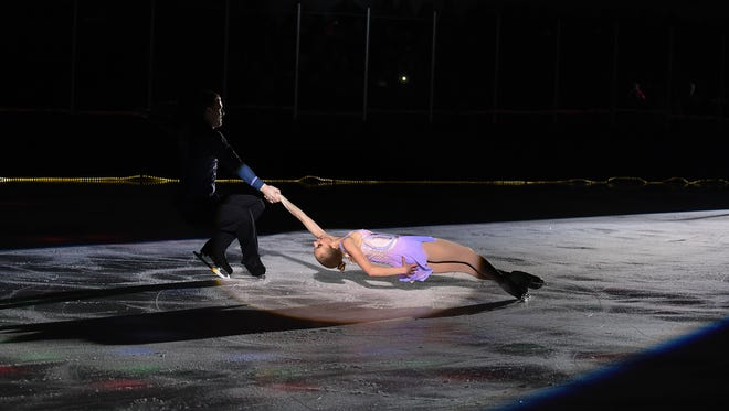"""Paige Connors and Evgeni Krasnapolski skate during """"Ice Dreams 2018"""" for the 20th anniversary celebration of the Ice House on Saturday January 27, 2018."""
