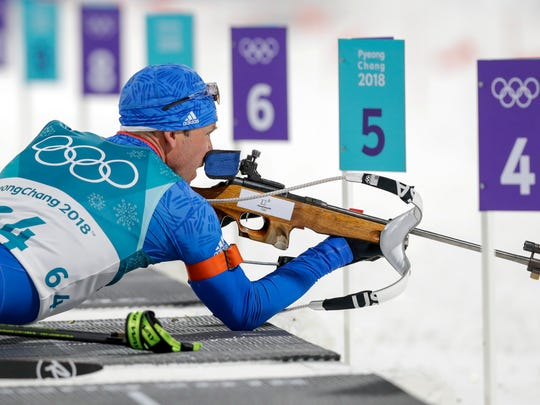 Lowell Bailey, of the United States, looks at the targets before shooting during the men's 10-kilometer biathlon sprint at the 2018 Winter Olympics in Pyeongchang, South Korea, Sunday, Feb. 11, 2018. (AP Photo/Andrew Medichini)