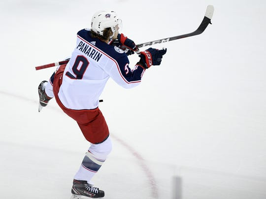 Columbus Blue Jackets left wing Artemi Panarin (9), of Russia, celebrates his goal during overtime of an NHL hockey game against the Washington Capitals, Saturday, Jan. 12, 2019, in Washington. (AP Photo/Nick Wass)