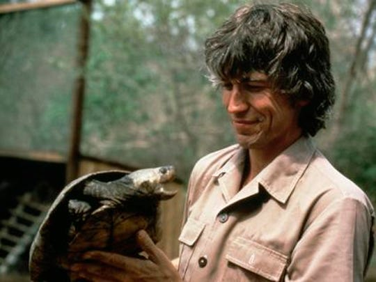 Russ Mittermeier holding Madagascar big-headed side neck turtle, Madagascar