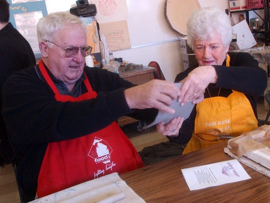 Pres Kool, left, helps his wife Marge with the clay