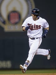 The Minnesota Twins' Brian Dozier runs the bases on a solo home run off Kansas City Royals pitcher Dillon Gee during the first inning Tuesday in Minneapolis.